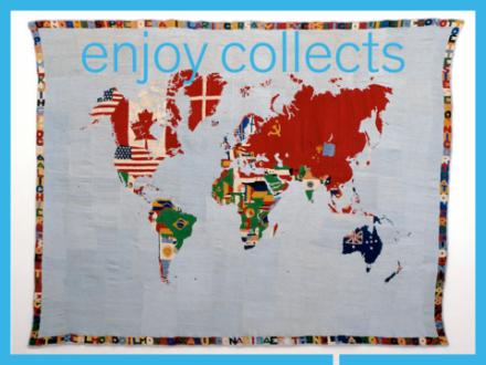 Gestickte bunte Weltkarte. Länder haben das Wappen eingestickt.