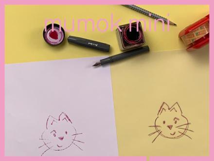 Gezeichneter Katzenkopf auf Papier